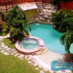 Pool with Waterfall (it has a full badroom and changing area below the deck) / Piscina con Cascada (con baño completo y area par acambiarse bajo la terraza)
